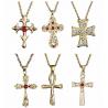 Crucifijos decorados en oro